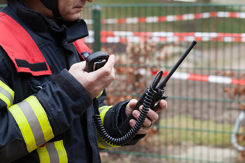 Firefighter uses a walkie talkie - ARCS design