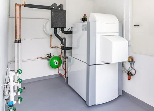 A domestic household boiler room with a new oil hot water heater design
