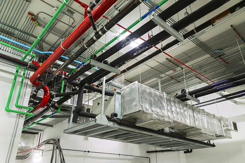 Ventilation system and pipes installed in industrial building.