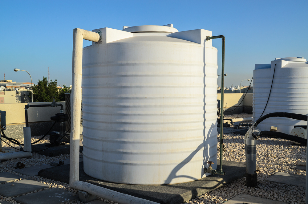 SS_White water tanks of industrial building on roof top