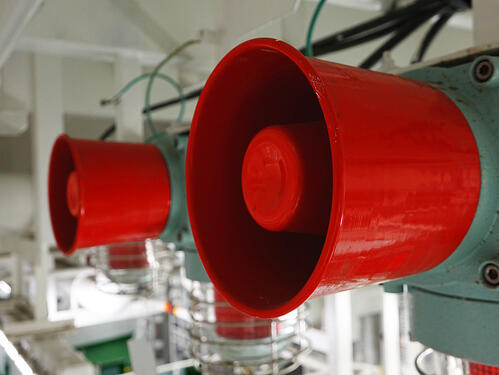 Red speakers for mass notification system design