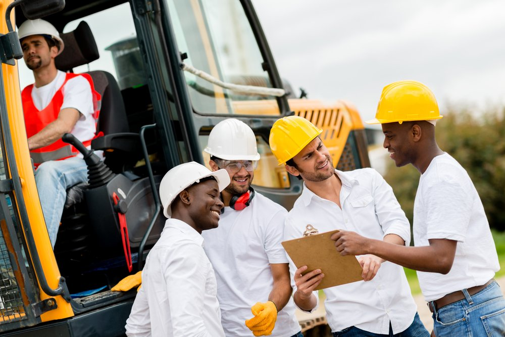 Group of engineers working at a construction site