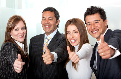 business group with thumbs-up at the office